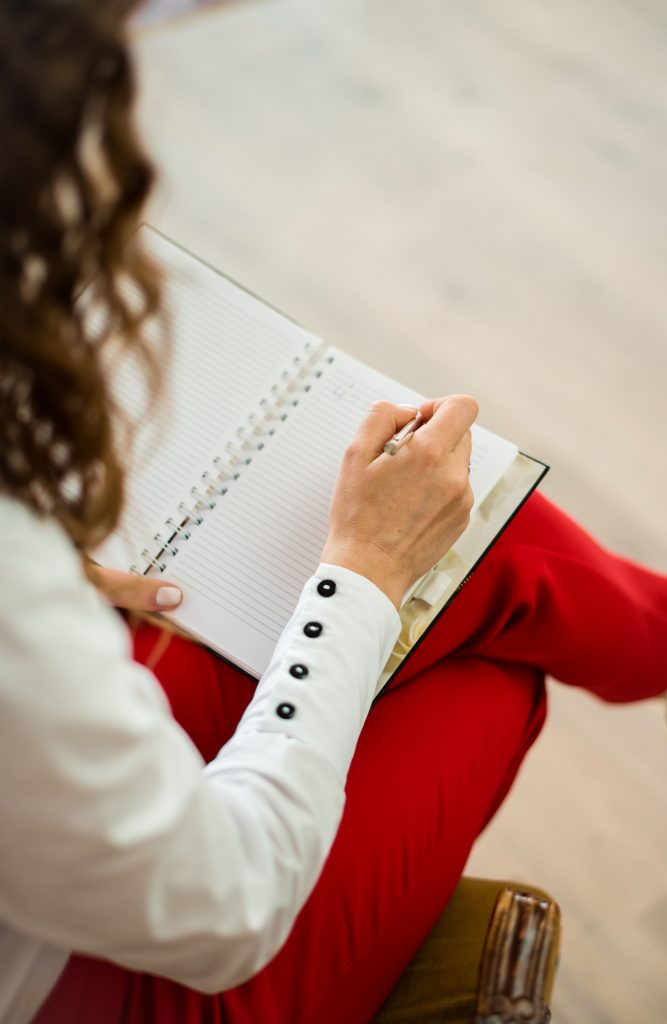 Therapist taking notes in a notebook.