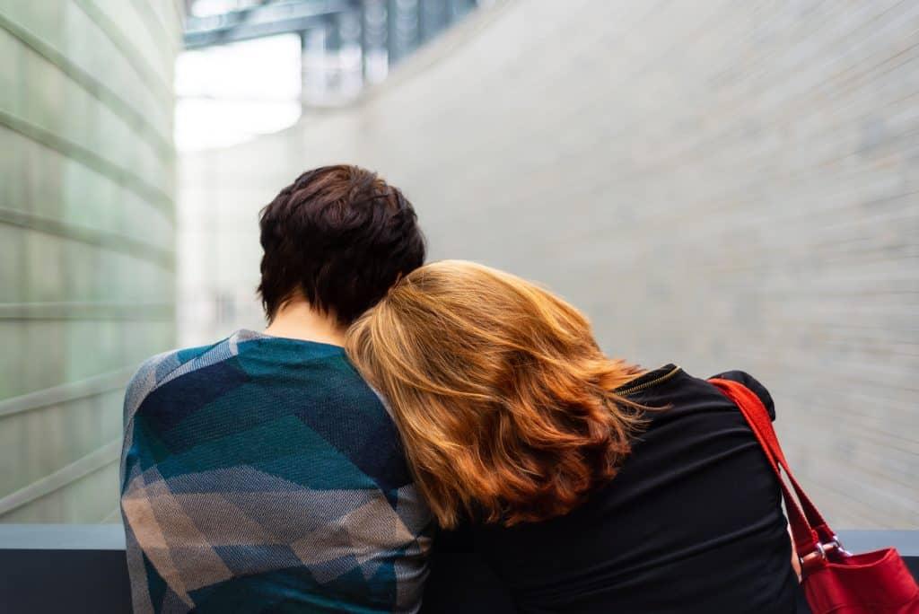 Empath resting on a friend's shoulder.