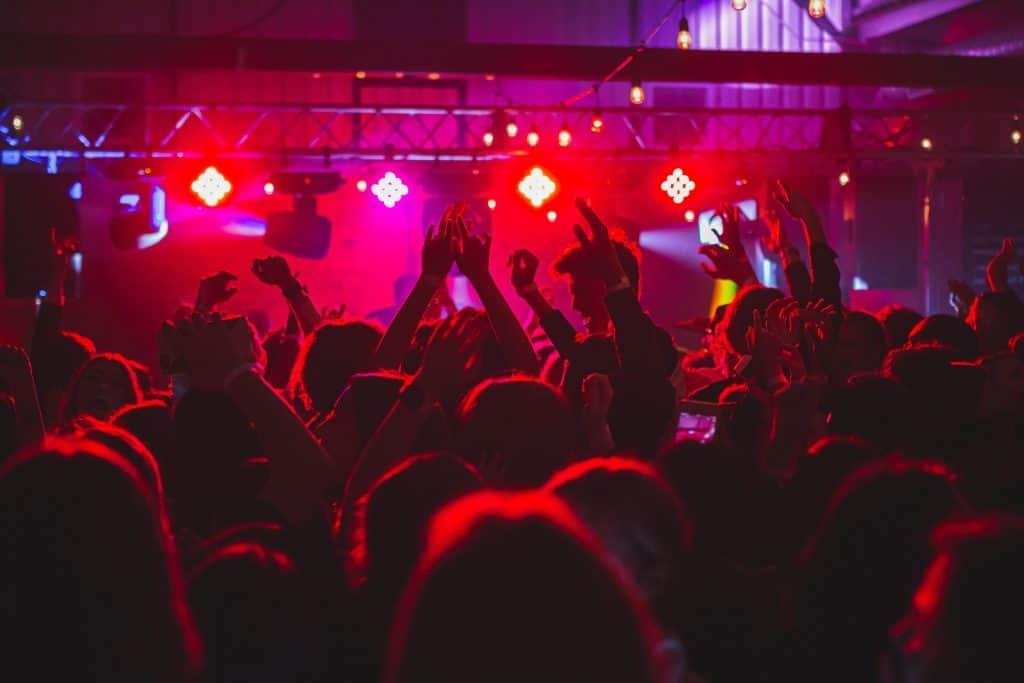 People on a nightclub dancefloor.